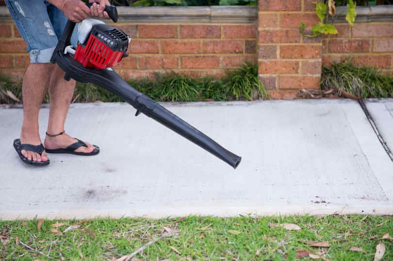 Man Using Battery Power Leaf blower